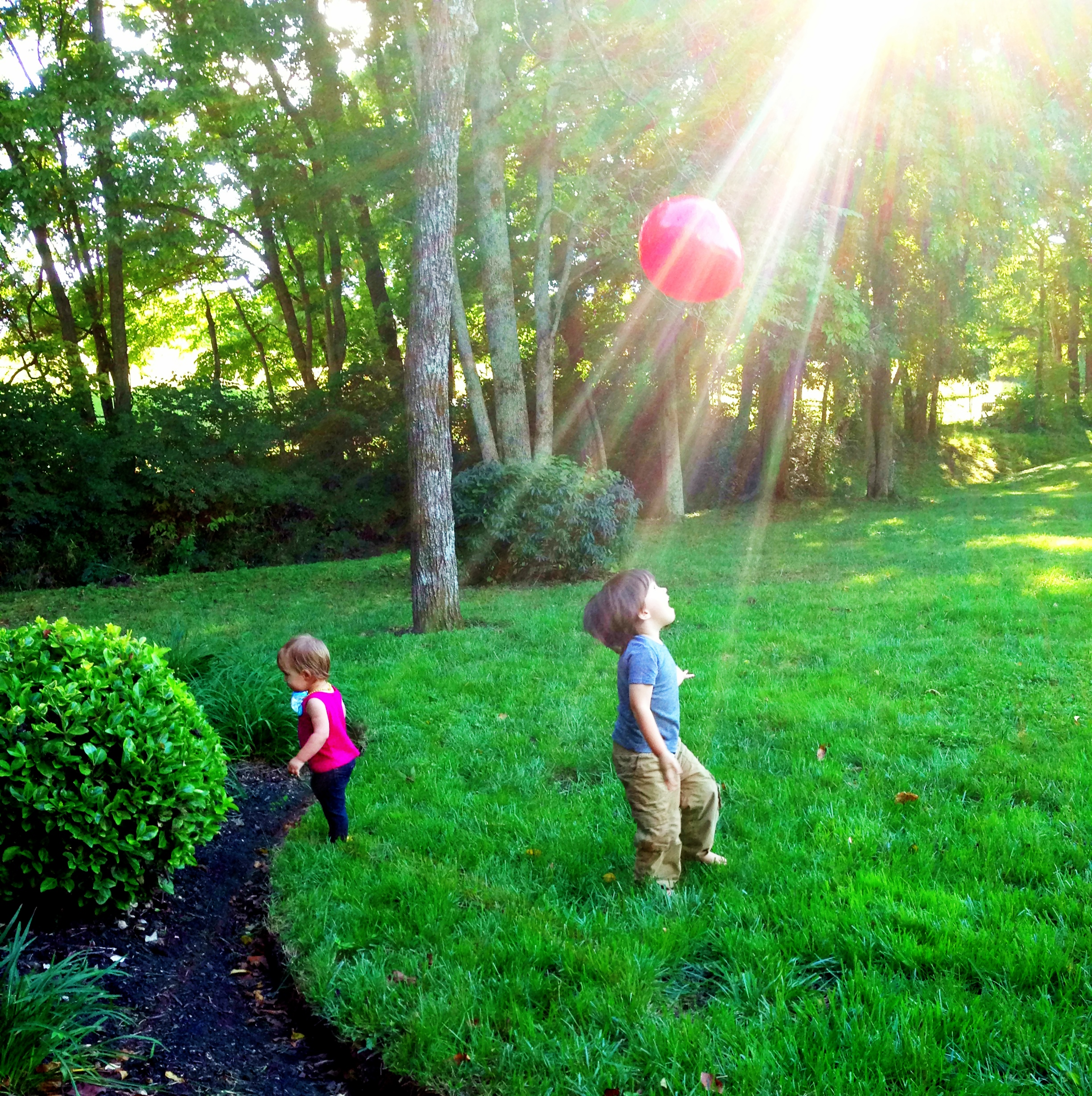 Grandchildren with a red balloon